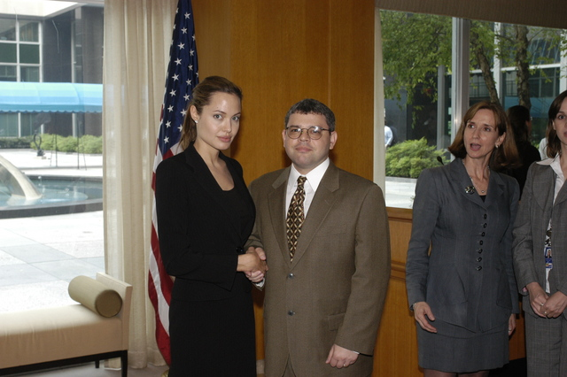 "[Assignment: 59-CF-DS-11872A-04] Reception at Harry S. Truman Building for actress Angelina Jolie, greeted by Department officials and staff [including Secretary Colin Powell, Under Secretary for Global Affairs Paula Dobriansky, and Secretary's Open Forum Chairman William Keppler. Jolie participated in Open Forum panel discussion of the documentary film that she narrated, ""Trading Women,"" an investigation of Southeast Asian sex trafficking.] [Photographer: Ann Thomas--State] [59-CF-DS-11872A-04_O_F_5_25_04_118.jpg]"