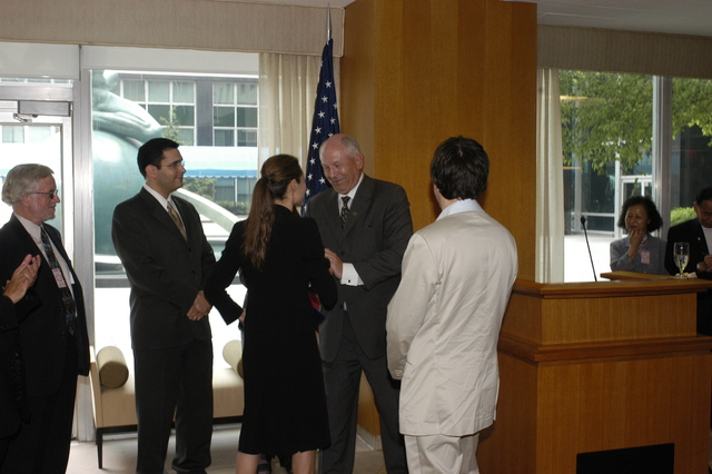 "[Assignment: 59-CF-DS-11872A-04] Reception at Harry S. Truman Building for actress Angelina Jolie, greeted by Department officials and staff [including Secretary Colin Powell, Under Secretary for Global Affairs Paula Dobriansky, and Secretary's Open Forum Chairman William Keppler. Jolie participated in Open Forum panel discussion of the documentary film that she narrated, ""Trading Women,"" an investigation of Southeast Asian sex trafficking.] [Photographer: Ann Thomas--State] [59-CF-DS-11872A-04_O_F_5_25_04_142.jpg]"