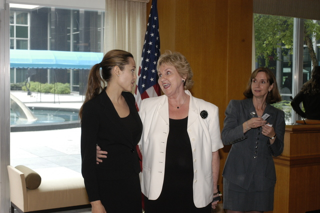 "[Assignment: 59-CF-DS-11872A-04] Reception at Harry S. Truman Building for actress Angelina Jolie, greeted by Department officials and staff [including Secretary Colin Powell, Under Secretary for Global Affairs Paula Dobriansky, and Secretary's Open Forum Chairman William Keppler. Jolie participated in Open Forum panel discussion of the documentary film that she narrated, ""Trading Women,"" an investigation of Southeast Asian sex trafficking.] [Photographer: Ann Thomas--State] [59-CF-DS-11872A-04_O_F_5_25_04_103.jpg]"