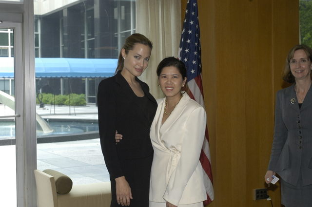 "[Assignment: 59-CF-DS-11872A-04] Reception at Harry S. Truman Building for actress Angelina Jolie, greeted by Department officials and staff [including Secretary Colin Powell, Under Secretary for Global Affairs Paula Dobriansky, and Secretary's Open Forum Chairman William Keppler. Jolie participated in Open Forum panel discussion of the documentary film that she narrated, ""Trading Women,"" an investigation of Southeast Asian sex trafficking.] [Photographer: Ann Thomas--State] [59-CF-DS-11872A-04_DSC_0061.JPG]"