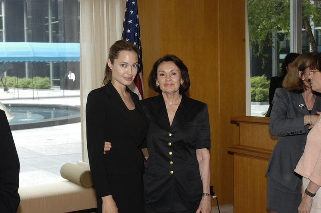 "[Assignment: 59-CF-DS-11872A-04] Reception at Harry S. Truman Building for actress Angelina Jolie, greeted by Department officials and staff [including Secretary Colin Powell, Under Secretary for Global Affairs Paula Dobriansky, and Secretary's Open Forum Chairman William Keppler. Jolie participated in Open Forum panel discussion of the documentary film that she narrated, ""Trading Women,"" an investigation of Southeast Asian sex trafficking.] [Photographer: Ann Thomas--State] [59-CF-DS-11872A-04_O_F_5_25_04_111.jpg]"