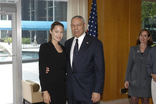 "[Assignment: 59-CF-DS-11872A-04] Reception at Harry S. Truman Building for actress Angelina Jolie, greeted by Department officials and staff [including Secretary Colin Powell, Under Secretary for Global Affairs Paula Dobriansky, and Secretary's Open Forum Chairman William Keppler. Jolie participated in Open Forum panel discussion of the documentary film that she narrated, ""Trading Women,"" an investigation of Southeast Asian sex trafficking.] [Photographer: Ann Thomas--State] [59-CF-DS-11872A-04_O_F_5_25_04_090.jpg]"