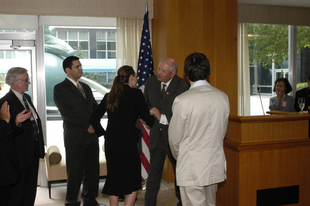 "[Assignment: 59-CF-DS-11872A-04] Reception at Harry S. Truman Building for actress Angelina Jolie, greeted by Department officials and staff [including Secretary Colin Powell, Under Secretary for Global Affairs Paula Dobriansky, and Secretary's Open Forum Chairman William Keppler. Jolie participated in Open Forum panel discussion of the documentary film that she narrated, ""Trading Women,"" an investigation of Southeast Asian sex trafficking.] [Photographer: Ann Thomas--State] [59-CF-DS-11872A-04_O_F_5_25_04_141.jpg]"