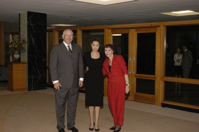 "[Assignment: 59-CF-DS-11872A-04] Reception at Harry S. Truman Building for actress Angelina Jolie, greeted by Department officials and staff [including Secretary Colin Powell, Under Secretary for Global Affairs Paula Dobriansky, and Secretary's Open Forum Chairman William Keppler. Jolie participated in Open Forum panel discussion of the documentary film that she narrated, ""Trading Women,"" an investigation of Southeast Asian sex trafficking.] [Photographer: Ann Thomas--State] [59-CF-DS-11872A-04_O_F_5_25_04_010.jpg]"