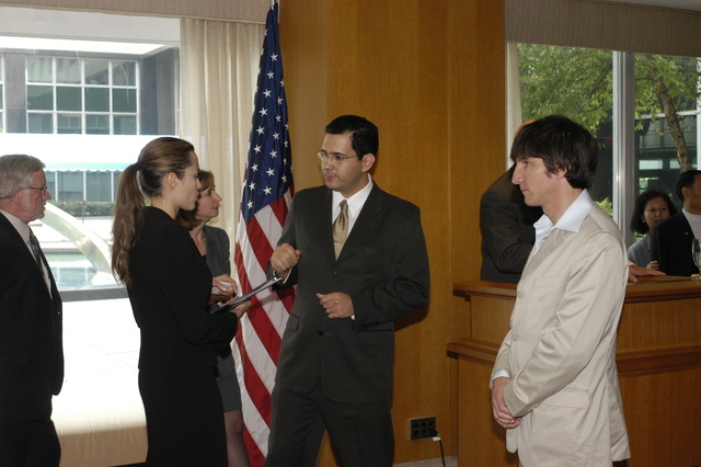 "[Assignment: 59-CF-DS-11872A-04] Reception at Harry S. Truman Building for actress Angelina Jolie, greeted by Department officials and staff [including Secretary Colin Powell, Under Secretary for Global Affairs Paula Dobriansky, and Secretary's Open Forum Chairman William Keppler. Jolie participated in Open Forum panel discussion of the documentary film that she narrated, ""Trading Women,"" an investigation of Southeast Asian sex trafficking.] [Photographer: Ann Thomas--State] [59-CF-DS-11872A-04_O_F_5_25_04_140.jpg]"