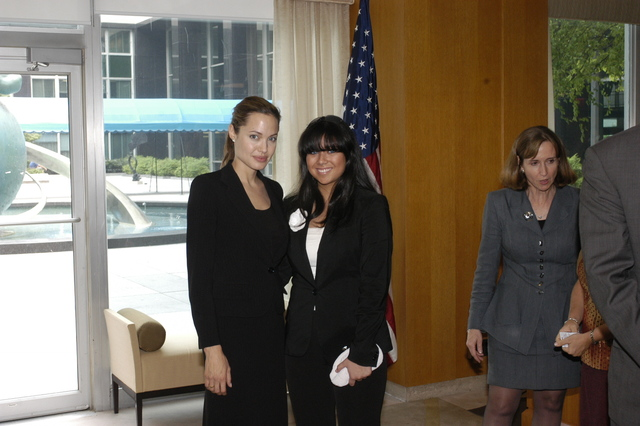 "[Assignment: 59-CF-DS-11872A-04] Reception at Harry S. Truman Building for actress Angelina Jolie, greeted by Department officials and staff [including Secretary Colin Powell, Under Secretary for Global Affairs Paula Dobriansky, and Secretary's Open Forum Chairman William Keppler. Jolie participated in Open Forum panel discussion of the documentary film that she narrated, ""Trading Women,"" an investigation of Southeast Asian sex trafficking.] [Photographer: Ann Thomas--State] [59-CF-DS-11872A-04_O_F_5_25_04_097.jpg]"