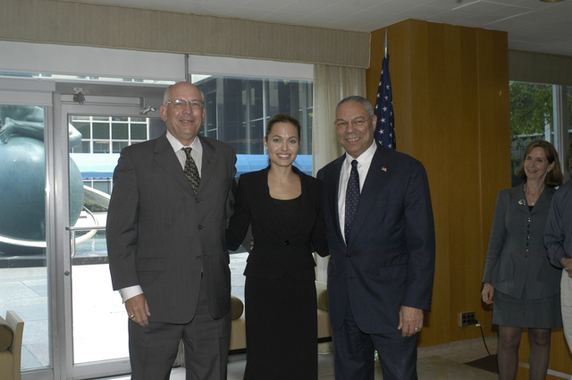 "[Assignment: 59-CF-DS-11872A-04] Reception at Harry S. Truman Building for actress Angelina Jolie, greeted by Department officials and staff [including Secretary Colin Powell, Under Secretary for Global Affairs Paula Dobriansky, and Secretary's Open Forum Chairman William Keppler. Jolie participated in Open Forum panel discussion of the documentary film that she narrated, ""Trading Women,"" an investigation of Southeast Asian sex trafficking.] [Photographer: Ann Thomas--State] [59-CF-DS-11872A-04_DSC_0020.JPG]"