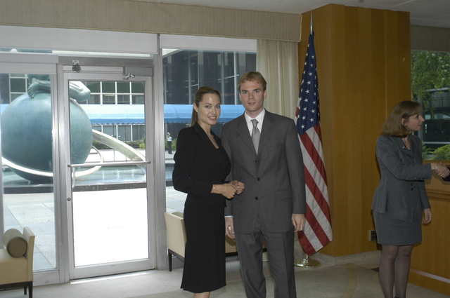 "[Assignment: 59-CF-DS-11872A-04] Reception at Harry S. Truman Building for actress Angelina Jolie, greeted by Department officials and staff [including Secretary Colin Powell, Under Secretary for Global Affairs Paula Dobriansky, and Secretary's Open Forum Chairman William Keppler. Jolie participated in Open Forum panel discussion of the documentary film that she narrated, ""Trading Women,"" an investigation of Southeast Asian sex trafficking.] [Photographer: Ann Thomas--State] [59-CF-DS-11872A-04_DSC_0025.JPG]"