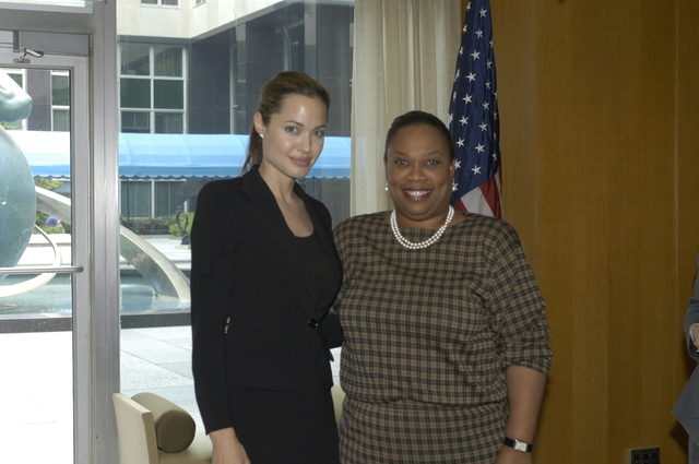 "[Assignment: 59-CF-DS-11872A-04] Reception at Harry S. Truman Building for actress Angelina Jolie, greeted by Department officials and staff [including Secretary Colin Powell, Under Secretary for Global Affairs Paula Dobriansky, and Secretary's Open Forum Chairman William Keppler. Jolie participated in Open Forum panel discussion of the documentary film that she narrated, ""Trading Women,"" an investigation of Southeast Asian sex trafficking.] [Photographer: Ann Thomas--State] [59-CF-DS-11872A-04_DSC_0064.JPG]"