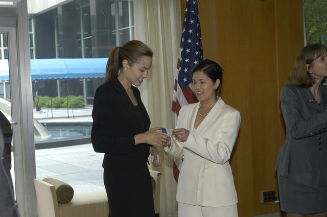 "[Assignment: 59-CF-DS-11872A-04] Reception at Harry S. Truman Building for actress Angelina Jolie, greeted by Department officials and staff [including Secretary Colin Powell, Under Secretary for Global Affairs Paula Dobriansky, and Secretary's Open Forum Chairman William Keppler. Jolie participated in Open Forum panel discussion of the documentary film that she narrated, ""Trading Women,"" an investigation of Southeast Asian sex trafficking.] [Photographer: Ann Thomas--State] [59-CF-DS-11872A-04_DSC_0059.JPG]"
