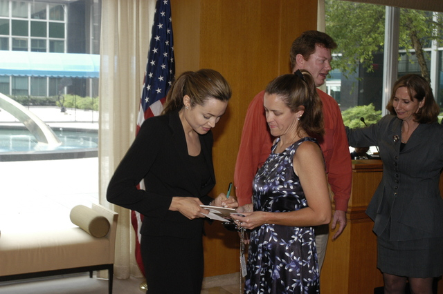 "[Assignment: 59-CF-DS-11872A-04] Reception at Harry S. Truman Building for actress Angelina Jolie, greeted by Department officials and staff [including Secretary Colin Powell, Under Secretary for Global Affairs Paula Dobriansky, and Secretary's Open Forum Chairman William Keppler. Jolie participated in Open Forum panel discussion of the documentary film that she narrated, ""Trading Women,"" an investigation of Southeast Asian sex trafficking.] [Photographer: Ann Thomas--State] [59-CF-DS-11872A-04_O_F_5_25_04_130.jpg]"