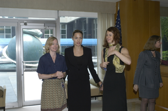 "[Assignment: 59-CF-DS-11872A-04] Reception at Harry S. Truman Building for actress Angelina Jolie, greeted by Department officials and staff [including Secretary Colin Powell, Under Secretary for Global Affairs Paula Dobriansky, and Secretary's Open Forum Chairman William Keppler. Jolie participated in Open Forum panel discussion of the documentary film that she narrated, ""Trading Women,"" an investigation of Southeast Asian sex trafficking.] [Photographer: Ann Thomas--State] [59-CF-DS-11872A-04_DSC_0007.JPG]"