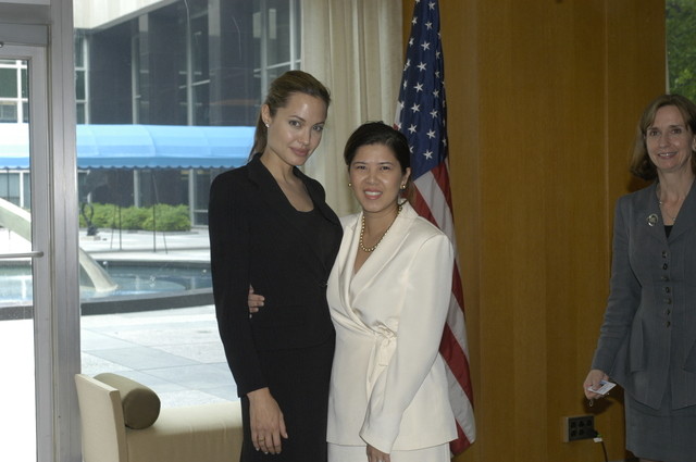 "[Assignment: 59-CF-DS-11872A-04] Reception at Harry S. Truman Building for actress Angelina Jolie, greeted by Department officials and staff [including Secretary Colin Powell, Under Secretary for Global Affairs Paula Dobriansky, and Secretary's Open Forum Chairman William Keppler. Jolie participated in Open Forum panel discussion of the documentary film that she narrated, ""Trading Women,"" an investigation of Southeast Asian sex trafficking.] [Photographer: Ann Thomas--State] [59-CF-DS-11872A-04_DSC_0060.JPG]"