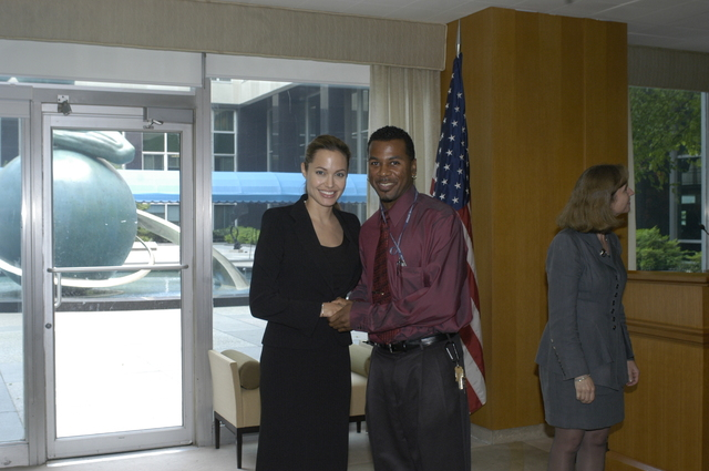 "[Assignment: 59-CF-DS-11872A-04] Reception at Harry S. Truman Building for actress Angelina Jolie, greeted by Department officials and staff [including Secretary Colin Powell, Under Secretary for Global Affairs Paula Dobriansky, and Secretary's Open Forum Chairman William Keppler. Jolie participated in Open Forum panel discussion of the documentary film that she narrated, ""Trading Women,"" an investigation of Southeast Asian sex trafficking.] [Photographer: Ann Thomas--State] [59-CF-DS-11872A-04_DSC_0009.JPG]"