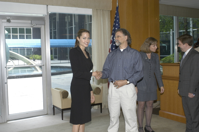 "[Assignment: 59-CF-DS-11872A-04] Reception at Harry S. Truman Building for actress Angelina Jolie, greeted by Department officials and staff [including Secretary Colin Powell, Under Secretary for Global Affairs Paula Dobriansky, and Secretary's Open Forum Chairman William Keppler. Jolie participated in Open Forum panel discussion of the documentary film that she narrated, ""Trading Women,"" an investigation of Southeast Asian sex trafficking.] [Photographer: Ann Thomas--State] [59-CF-DS-11872A-04_DSC_0022.JPG]"