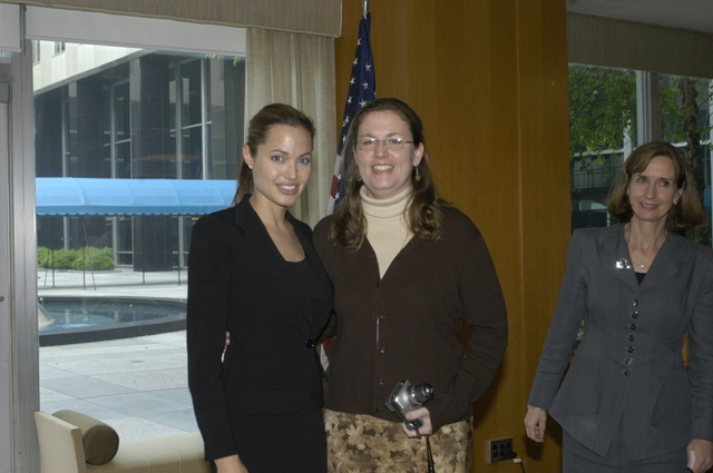 "[Assignment: 59-CF-DS-11872A-04] Reception at Harry S. Truman Building for actress Angelina Jolie, greeted by Department officials and staff [including Secretary Colin Powell, Under Secretary for Global Affairs Paula Dobriansky, and Secretary's Open Forum Chairman William Keppler. Jolie participated in Open Forum panel discussion of the documentary film that she narrated, ""Trading Women,"" an investigation of Southeast Asian sex trafficking.] [Photographer: Ann Thomas--State] [59-CF-DS-11872A-04_DSC_0039.JPG]"