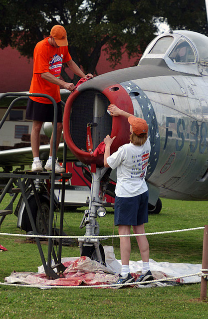 US Air Force (USAF) 2nd Lieutenant (2LT) Matthew Robey (left) and 2LT Michelle Taylor of the 2nd Munitions Squadron (MS), Barksdale Air Force Base (AFB), Louisiana (LA), do a hands-on restoration of the 8th Air Force Museums F-84F Thunderstreak fighter aircraft