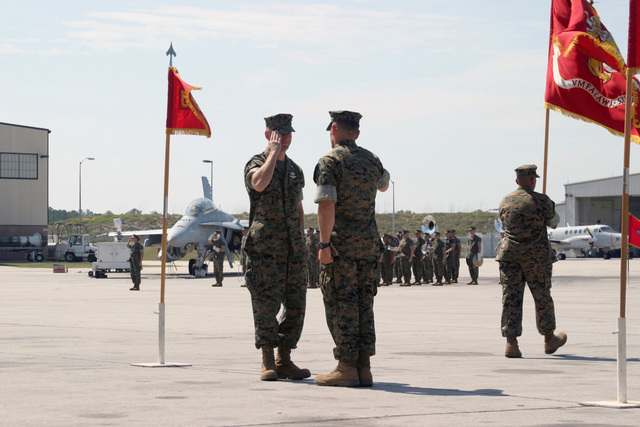 US Marine Corps (USMC) Lieutenant Colonel (LCT) L. Ross Roberts (foreground), Out-going Commander, Marine Fighter Attack Squadron Five Three Three (VMFA- 533), relinquishes his command to In-Coming Commander, USMC LTC Mark G. Mykleby, during the Change of Command Ceremony for VMFA- 533, aboard Marine Corps Air Station (MCAS) Beaufort, South Carolina (SC). Sergeant Major (SGM) Scott C. Mykoo, acts as flag bearer