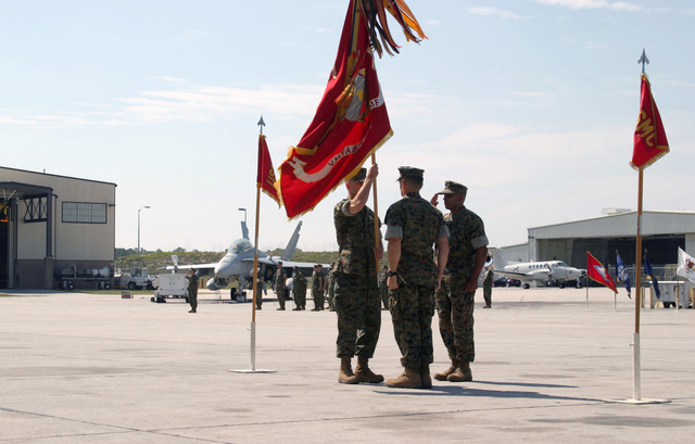 US Marine Corps (USMC) Lieutenant Colonel (LCT) L. Ross Roberts (foreground), Out-going Commander, Marine Fighter Attack Squadron Five Three Three (VMFA- 533), passes the Unit Colors to In-Coming Commander, USMC LTC Mark G. Mykleby, during the Change of Command Ceremony for VMFA- 533, aboard Marine Corps Air Station (MCAS) Beaufort, South Carolina (SC). Sergeant Major (SGM) Scott C. Mykoo, acts as flag bearer