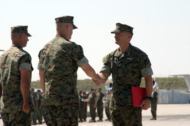 US Marine Corps (USMC) Lieutenant Colonel (LCT) L. Ross Roberts (right), Out-going Commander, Marine Fighter Attack Squadron Five Three Three (VMFA- 533), receives the Meritorious Service Medal award from USMC Colonel (COL) David H. Peeler, Commanding Officer, Marine Aircraft Group Three One (MAG-31), during the Change of Command Ceremony for VMFA- 533, aboard Marine Corps Air Station (MCAS) Beaufort, South Carolina (SC). During the Ceremony Lieutenant Colonel (LCT) L. Ross Roberts relinquished his command to In-Coming Commander, USMC LTC Mark G. Mykleby, who is pictured left