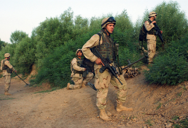 US Army (USA) Scouts from HHC 1-77th Armor Battalion, Schweinfurt, Germany (DEU), provide perimeter security for other Scouts during local Operation Rocket Man in support of Operation IRAQI FREEDOM. USA Scouts are armed with 5.56 mm M16A2 Automatic Rifles