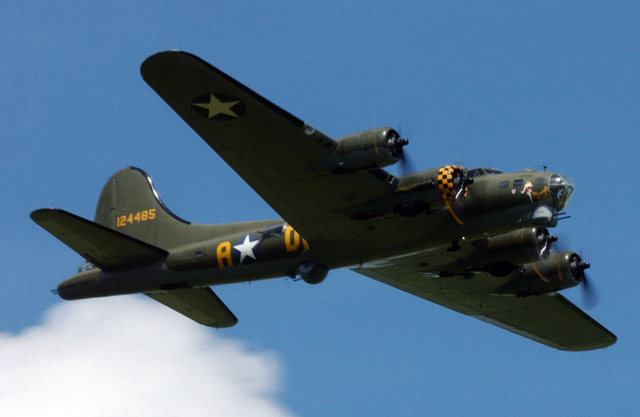 "The ""Sally B"" B-17 Flying Fortress bomber aircraft flies overhead during the Memorial Day ceremony held at the Madingley American Cemetery near the city of Cambridge, England (ENG), in honor of the World War II fallen"