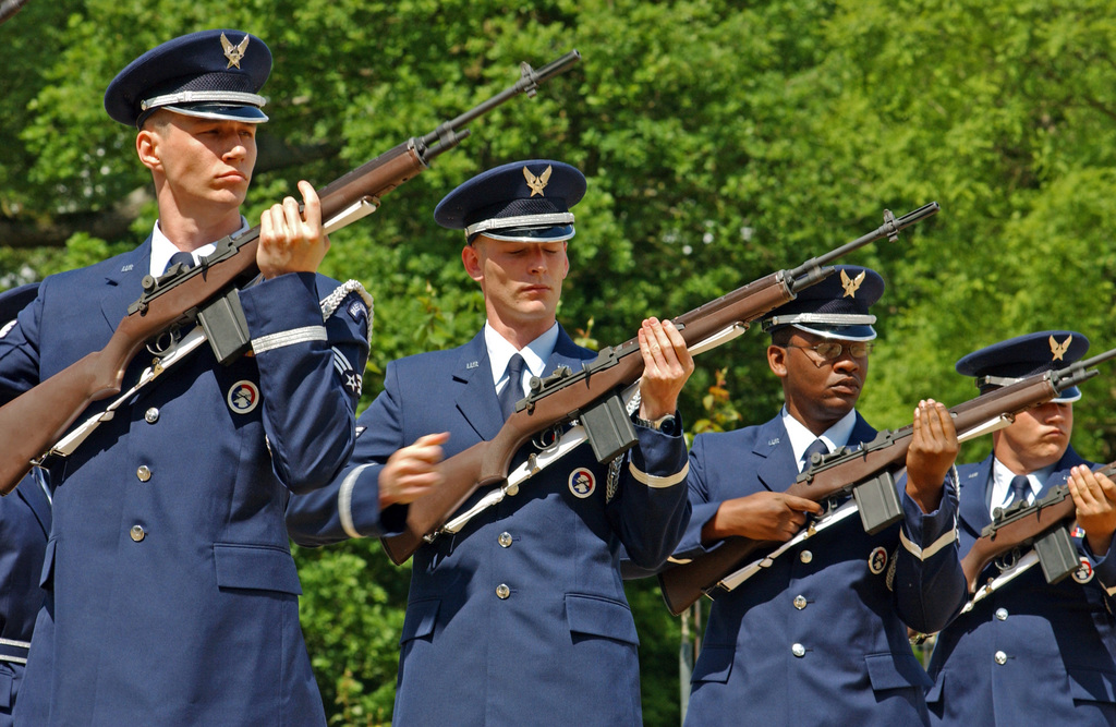 US Air Force (USAF) members of the 48th Fighter Wing (FW) Honor Guard, RAF (Royal Air Force) Lakenheath, United Kingdom (UK) render a 21-gun salute during the Madingley Memorial Ceremony at the Cambridge American Military Cemetery in the United Kingdom. The cemetery is one of 13 American World War II (WWII) military cemetery memorials erected on foreign soil where 3,812 Americans are buried. The cemetery first established on December 7, 1943, and completed in 1956