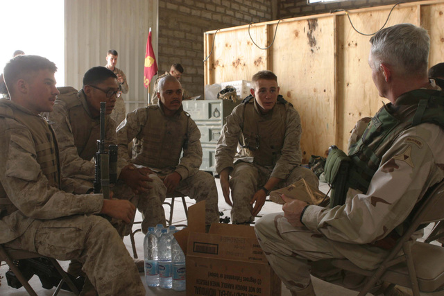 US Army (USA) Lieutenant General Thomas F. Metz, Commanding General III Corps, speaks with US Marine Corps (USMC) Marines of Bravo Company, 1ST Battalion (BN), 5th Marines (MAR), 1ST Marine Division (MAR DIV), after sharing lunch with them in Al Shahabi, Iraq, during Operation IRAQI FREEDOM. The 1ST MAR DIV is engaged in Security and Stabilization Operations (SASO) in the area