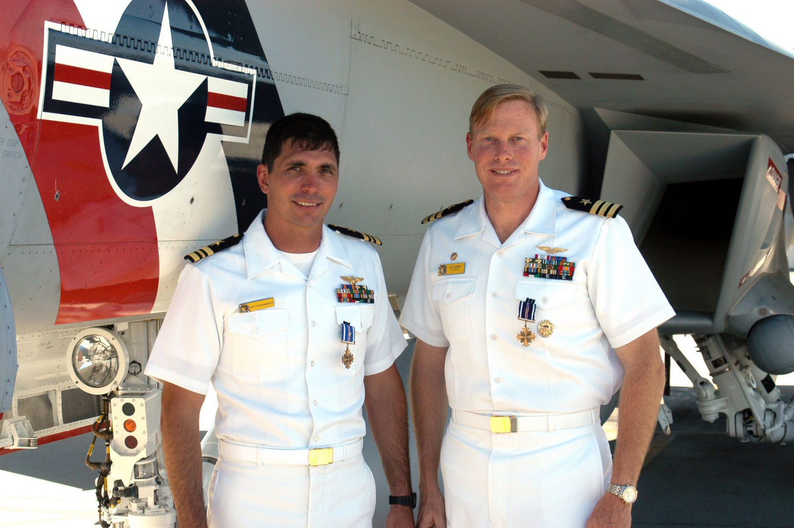 US Navy (USN) Lieutenant Commander (LCDR) Kurt Frankenberger (left), and USN Commander (CDR) Doug Denneny, both assigned to Strike Fighter Squadron Two (VFA-2), pose for a photograph standing in front of a USN F/A-18F Super Hornet aircraft, after being awarded the Distinguished Flying Cross with Valor, during a Ceremony held aboard Naval Air Station (NAS) Lemoore, California (CA). The Navy Officers distinguished themselves during combat action flown in support of Operation IRAQI FREEDDOM (OIF)