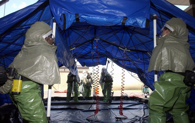 US Air Force (USAF) Airmen of the Patient Decontamination Team, 305th Medical Group (MDG), McGuire Air Force Base (AFB), New Jersey (NJ), set up an In Place Patient Decontamination Tent during a simulated bomb threat and chemical warfare attack at McGuire's Base Exchange (BX) during a base exercise