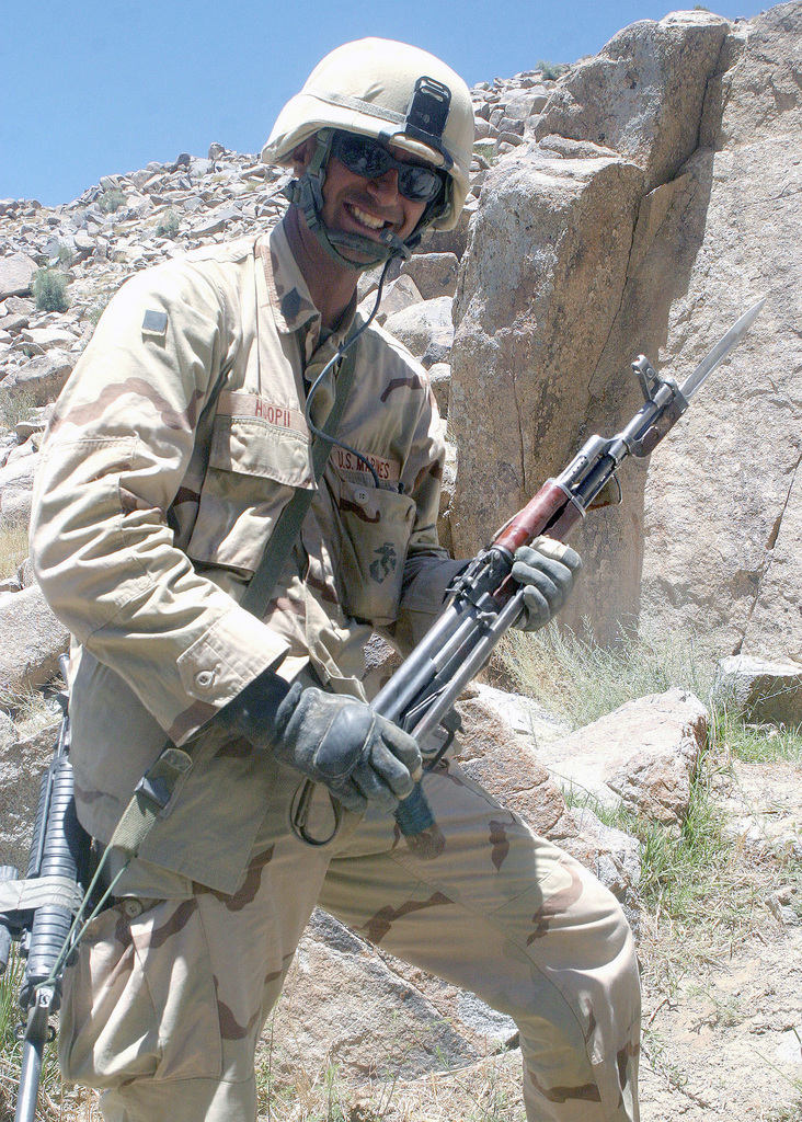 US Marine Corps (USMC) First Sergeant (1SGT) Ernest Hoopii, assigned to the Battalion Landing Team (BLT), 1ST Battalion, 6th Marines, 22nd Marine Expeditionary Unit (), Special Operations Capable (SOC), poses for a photograph holding a 5.56 mm AK-74 assault rifle taken from a slain enemy fighter after a firefight with Taliban insurgents near the village of Khabargho, Afghanistan during Operation Asbury Park. The ensuing firefight resulted in five Taliban fighters dead, three Marines wounded, and three enemy combatants being captured. During eight days of intense fighting more than 80 Taliban fighters were killed while eight Marines were wounded in the most intense clashes during the...