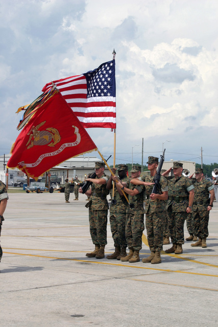 A US Marine Corps (USMC) Color Guard presents the Colors during the Change of Command Ceremony for Marine Fighter Attack Squadron Three One Two (VMFA-312), aboard Marine Corps Air Station (MCAS) Beaufort, South Carolina (SC). During the Ceremony Lieutenant Colonel (LCT) Jack R. Snider relinquished his command to In-Coming Commander, USMC LTC Douglas A. Denn