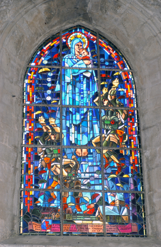 In the church of St Mere Eglise, France (FRA), this stained glass window shows the arrival of the US Army (USA) 82nd Airborne paratroopers as they were dropped over the town on D-Day, June 6, 1944