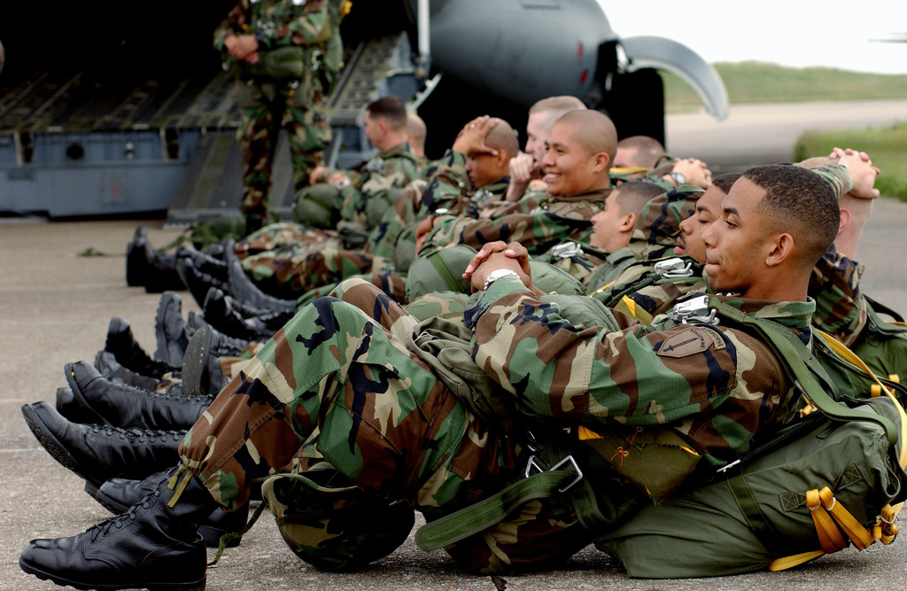 US Army (USA) Soldiers, 1ST Battalion (BN), 507th Parachute Infantry Regiment (PIR), Fort Benning, Georgia (GA), relax before loading onto four US Air Force (USAF) C-17A Globemaster III cargo aircraft. They will be part of a 16 aircraft paratroop drop celebrating the 60th Anniversary of the D-Day Normandy invasion during World War II (WWII)