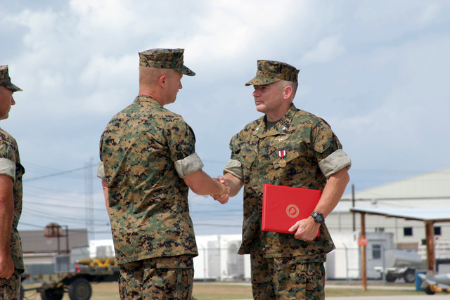 US Marine Corps (USMC) Lieutenant Colonel (LCT) Jack R. Snider (right), Out- Going Commander, Marine Fighter Attack Squadron Three One Two (VMFA-312), receives the Meritorious Service Medal award from USMC Colonel (COL) David H. Peeler, Commanding Officer, Marine Aircraft Group Three One (MAG-31), during the Change of Command Ceremony aboard Marine Corps Air Station (MCAS) Beaufort, South Carolina (SC)