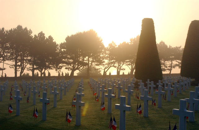 The sun rises over the American Military Cemetery at Colleville sur Mer, France (FRA), above the Omaha Beach section of Normandy, 60 years after the D-Day invasions of World War II (WWII)