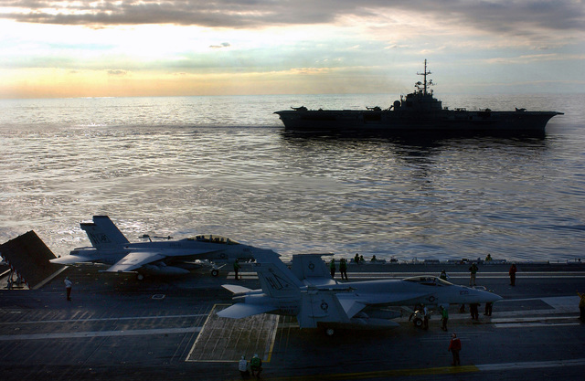 A US Navy (USN) F/A-18E Super Hornet, Strike Fighter Squadron Fourteen (VFA-14), Tophatters (right), and a USN F/A-18F Super Hornet, Strike Fighter Squadron Four One (VFA-41), Black Aces, prepare to launch from the USN Nimitz Class Aircraft Carrier USS RONALD REAGAN (CVN 76). The Brazilian Navy Clemenceau Class Aircraft Carrier BNS SAO PAULO (A 12) cruises along side. The RONALD REAGAN and its crew are underway circumnavigating South America as they make their way to their new homeport at San Diego, California (CA)