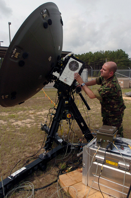 British Royal Air Force (RAF) SENIOR Aircraftsman (SAC) John Mitchell of the works on a communications dish at Shaw Air Force Base (AFB), South Carolina (SC), during the Combined Joint Task Force Exercise (CJTFEX) 04-2