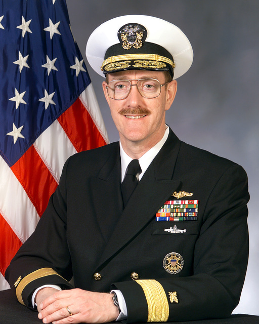 Portrait: US Navy (USN) Rear Admiral (RDML) (lower half) Martin J. Brown, Deputy for Acquisition and Business Management, Office of the Assistant Secretary of the Navy for Research and Development and Acquisition. (Covered)