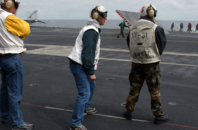 The Lieutenant Governor of Alaska, Mr. Loren Leman (center), observes flight operations from e flightdeck aboard e Nimitz Class Aircraft Carrier USS JOHN C. STENNIS (CVN 74). STENNIS and embarked Carrier Air Wing 14 (CVW-14) are currently at sea participating in Exercise NORTHERN EDGE 2004 during eir regularly scheduled deployment. Simultaneously STENNIS is one of seven aircraft carriers involved in SUMMER PULSE 2004. SUMMER PULSE 2004 is e simultaneous deployment of seven Carrier Strike Groups (CSG), demonstrating e ability of e Navy to provide credible combat power across e globe, in five eaters wi oer US, Allied, and coalition military forces. SUMMER PULSE 2004 is...