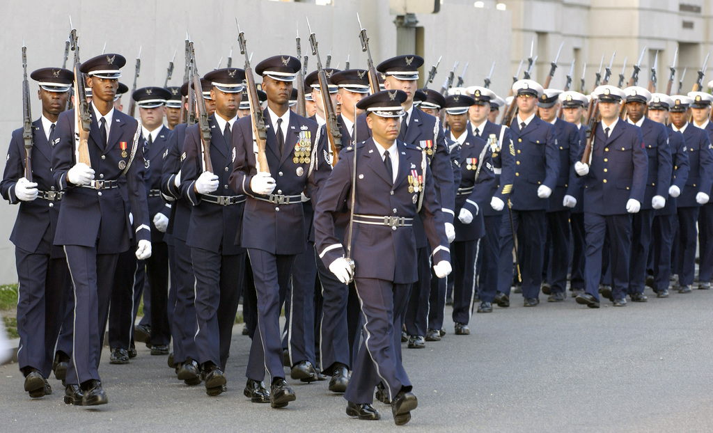 The US Air Force (USAF) Honor Guard leads a Joint Service Guard (JSG) on a funeral march from the United States Capitol building and follow the casket of the 40th President of the US Ronald Wilson Reagan, in procession down Constitution Avenue in Washington DC