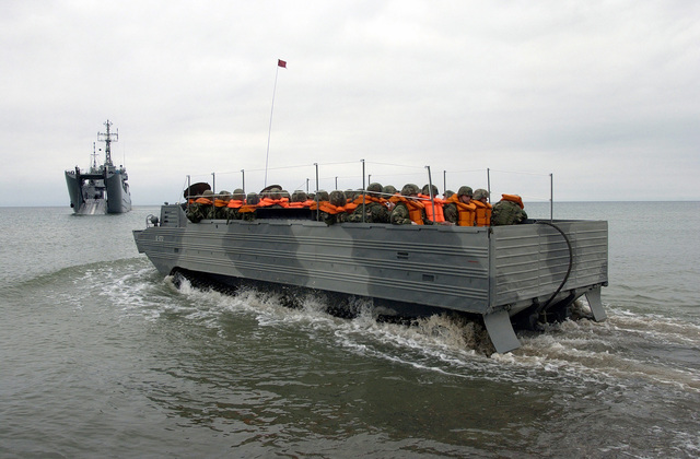 A Polish Amphibious Vehicle containing US Marine Reservists, Bravo Company, 1ST Battalion, 24th Marine Division, enters the Baltic Sea to embark the Polish Lublin Class (Type 767) LCT/Minelayer ORP POZNAN (824), during a Baltic Operations (BALTOPS) 2004 beach assault exercise. The mission of BALTOPS 2004 is to promote mutual understanding, confidence, cooperation, and interoperability among forces and personnel of the participating nations and support national unit/staff training objectives through a series of robust training exercises