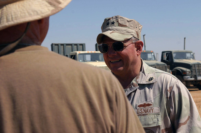Al Walbde, Iraq (IRQ), US Navy (USN) Rear Admiral (RADM) Charles Kubic (right), Commander of First Naval Construction Division, speaks with personnel from Sea Bees Detachment 14 about their progress with the construction of an Iraqi border patrol camp on the Syrian border, in support of Operation IRAQI FREEDOM