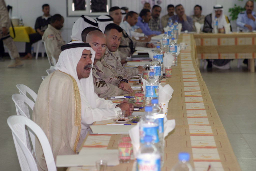 Local Iraqi leaders from the Al Anbar Province address their concerns at a Security Conference held in Al Asad, Iraq. This conference was set-up by the US Marine Corps (USMC) 7th Marine Regiment, 1ST Marine Division (MAR DIV), during a Security and Stabilization Operation (SASO) in Al Anbar Province in support of Operation IRAQI FREEDOM