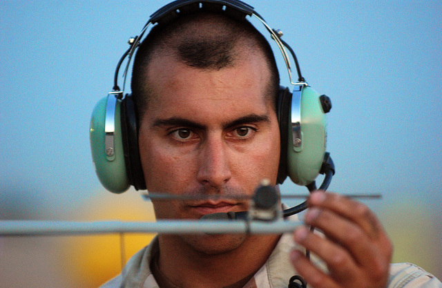 US Air Force (USAF) STAFF Sergeant (SSGT) David Miranda, a Dedicated Crew CHIEF on a MQ-1L Predator Unmanned Aerial Vehicle (UAV), inspects the angle of an attached instrument on its engine during a Preventative Maintenance Inspection (PMI). Miranda is assigned to the 46th Expeditionary Reconnaissance Squadron (ERS) at Balad Air Base (AB), Iraq (IRQ)