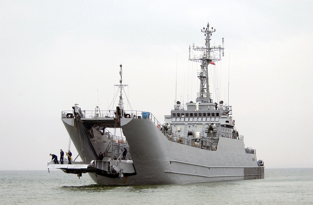 The Polish Lublin Class (Type 767) LCT/Minelayer ORP POZNAN (824) opens its ramp in preparation to receive a combat raiding raft during Baltic Operations (BALTOPS) 2004. The mission of BALTOPS 2004 is to promote mutual understanding, confidence, cooperation, and interoperability among forces and personnel of the participating nations and support national unit/staff training objectives through a series of robust training exercises