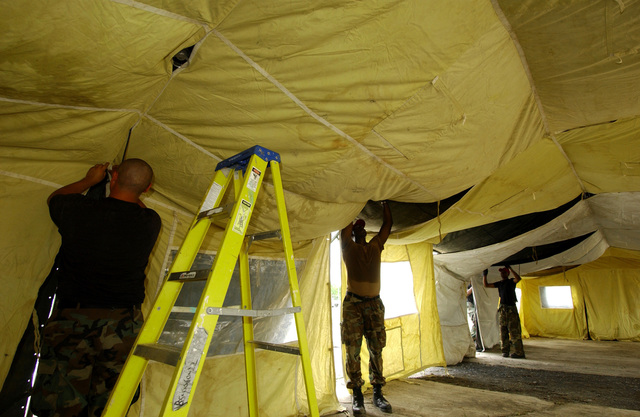US Air Force (USAF) members of 820th RED HORSE (Rapid Engineer Deployable Heavy Operational Repair Squadron Engineers) Squadron, Nellis Air Force Base (AFB), Nevada (NV), construct tents on Camp Stephenson, Timehri, Guyana (GUY). NEW HORIZONS 2004-Guyana is a joint service training exercise held in Guyana, co-sponsored by both the US Southern Command (SOUTHCOM) in Miami, Florida (FL) and the Guyana Defense Force (GDF). During this four-month exercise, a combined team of GDF and US military personnel will be engaged in construction projects and medical training activities, directly benefiting the local community. The exercise will include up to three construction projects and two...