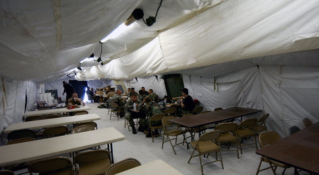 US Air Force (USAF) Civil Engineers of the 820th RED HORSE (Rapid Engineer Deployable Heavy Operational Repair Squadron Engineers), Nellis Air Force Base (AFB), Nevada (NV), constructed this dining facility in just two days during Exercise NEW HORIZONS 2004-GUYANA at Camp Stephenson, Timehri, Guyana (GUY). NEW HORIZONS 2004 is a joint service training se held in Guyana, co-sponsored by both the US Southern Command (SOUTHCOM) in Miami, Florida (FL) and the Guyana Defense Force (GDF). During this four-month se, a combined team of GDF and US military personnel will engage in construction projects and medical training activities that directly benefit the local community. The...