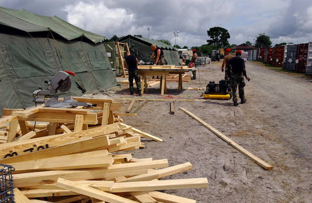 US Air Force (USAF) members of the 820th RED HORSE (Rapid Engineer Deployable Heavy Operational Repair Squadron Engineers), Nellis Air Force Base (AFB), Nevada (NV), cut lumber to make tent flooring during Exercise NEW HORIZONS 2004-GUYANA at Camp Stephenson, Timehri, Guyana (GUY). NEW HORIZONS 2004 is a joint service training exercise held in Guyana, co-sponsored by both the US Southern Command (SOUTHCOM) in Miami, Florida (FL) and the Guyana Defense Force (GDF). During this four-month exercise, a combined team of GDF and US military personnel will engage in construction projects and medical training activities that directly benefit the local community. The exercise will include up to...