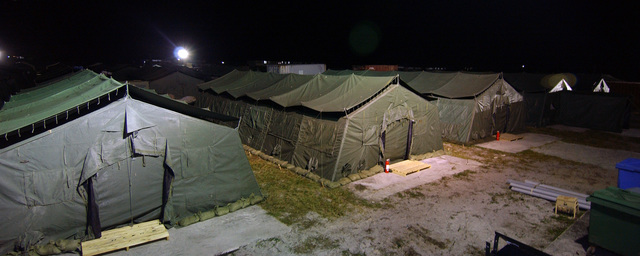 Tent city on Camp Stephenson, Timehri, Guyana (GUY), at night during Exercise NEW HORIZONS 2004-GUYANA. NEW HORIZONS 2004 is a joint service training exercise held in Guyana, co-sponsored by both the US Southern Command (SOUTHCOM) in Miami, Florida (FL) and the Guyana Defense Force (GDF). During this four-month exercise, a combined team of GDF and US military personnel will engaged in construction projects and medical training activities that directly benefit the local community. The exercise will include up to three construction projects and two Medical Readiness Training Exercises (MEDRETE)